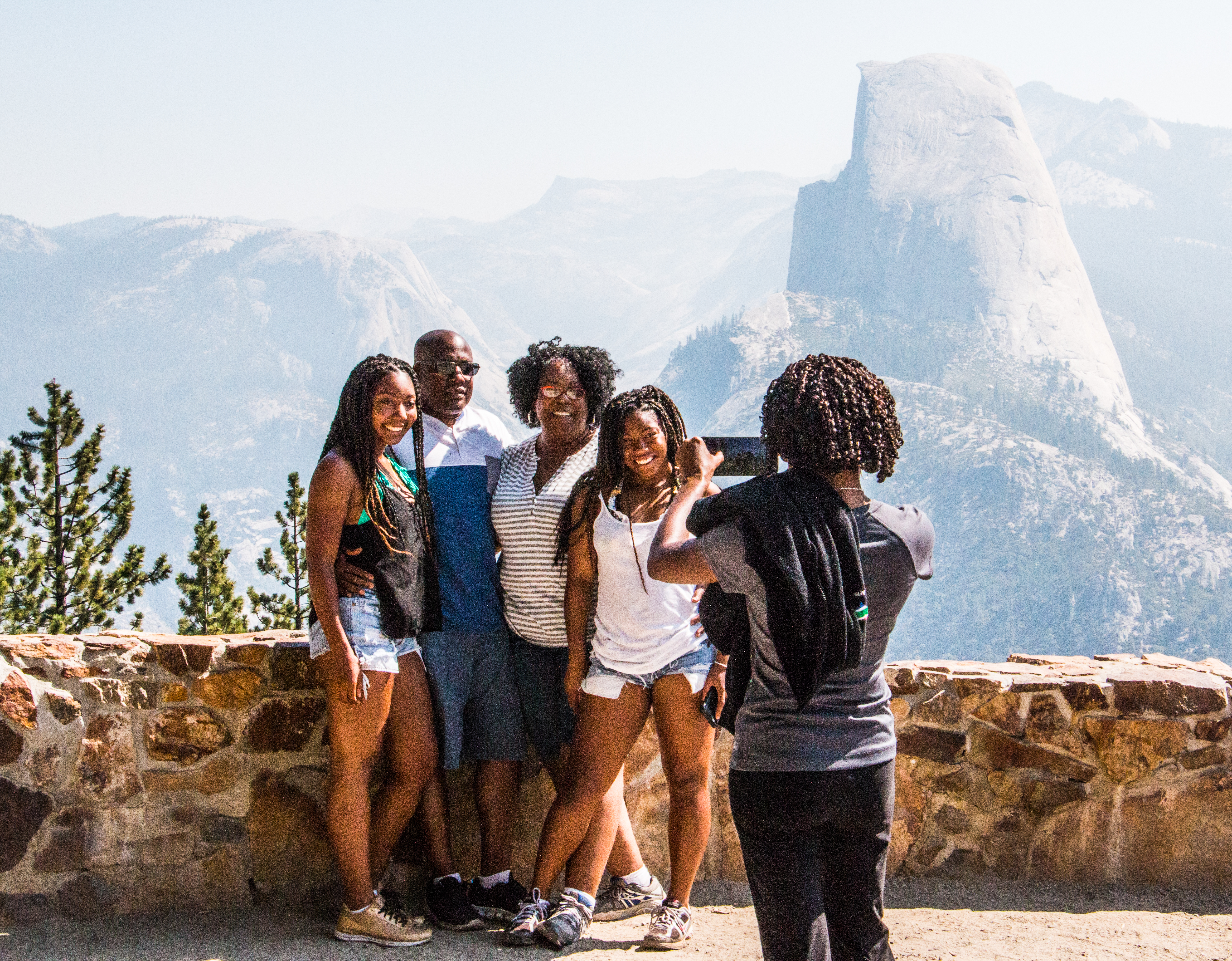 The King Family from Los Angeles visiting Yosemite for the first time take in the view of Half Dome from Glacier Point